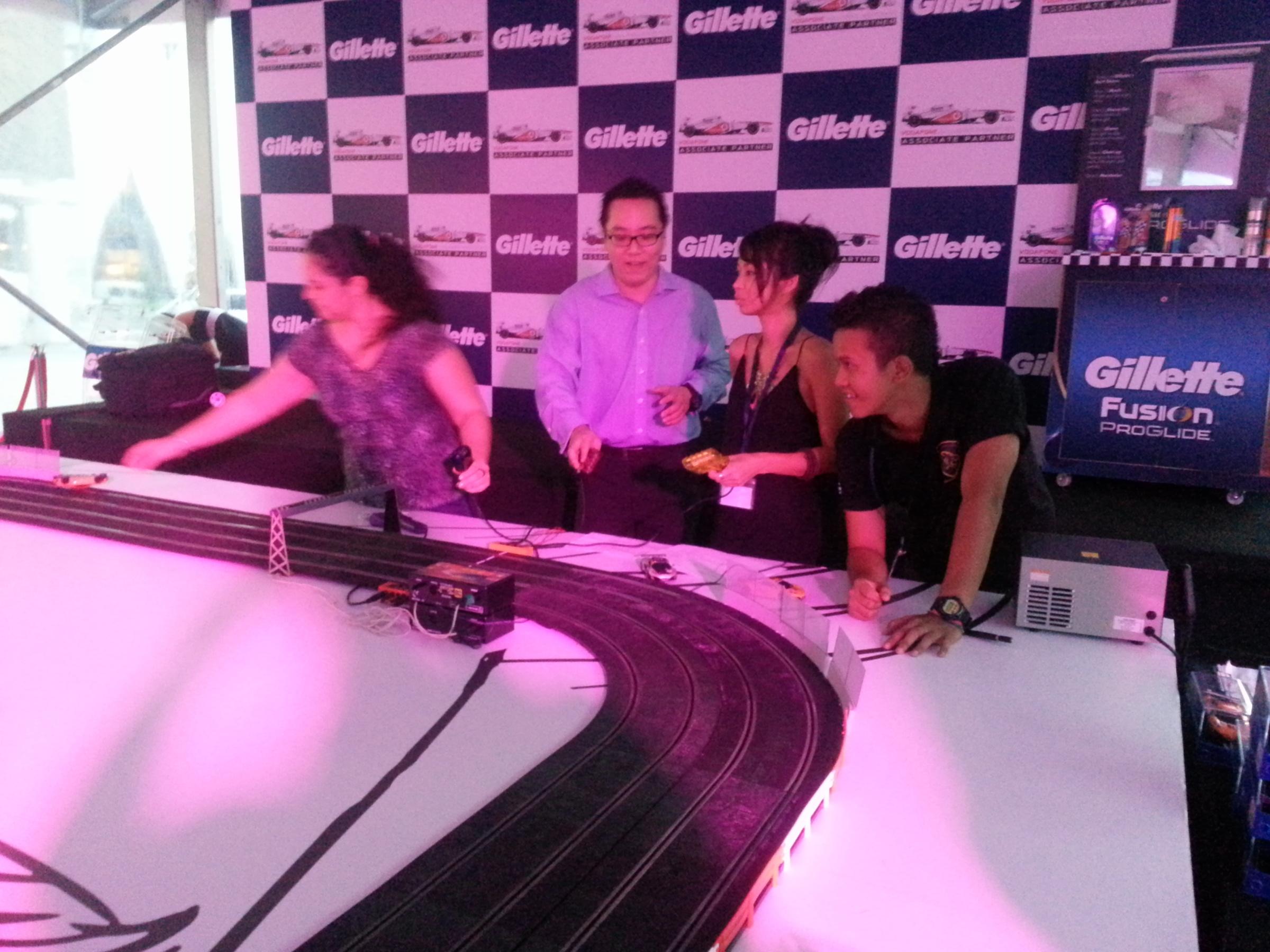 slot car racing, vivocity, gilette, mika hakkinen, f1 singapore, singapore night race